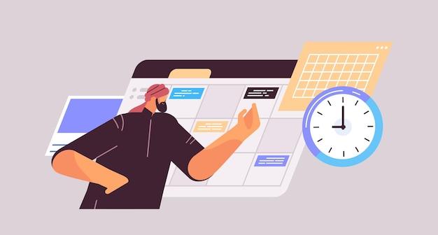 Geschäftsmann, der den tag plant, termin in der online-kalender-app zu planen, termin für das zeitmanagement