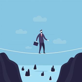 Geschäftsmann, der durch lücke auf einem drahtseil geht