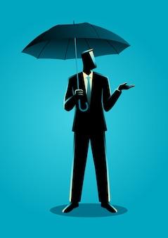Geschäftsmann, der einen regenschirm hält