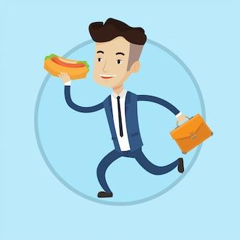 Geschäftsmann, der hot dog auf der flucht isst.