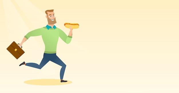 Geschäftsmann, der hotdog isst