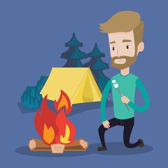 Geschäftsmann, der marshmallow über lagerfeuer röstet.