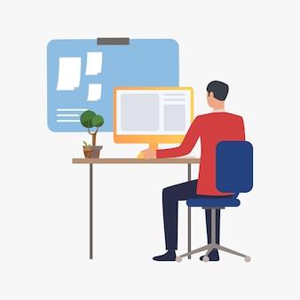 Geschäftsmann, der mit computer im büro arbeitet