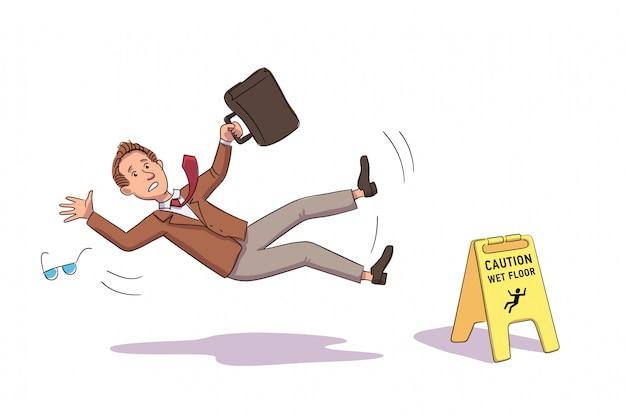 Geschäftsmann, der nahe vorsicht gelbes boden gelbes schild fällt