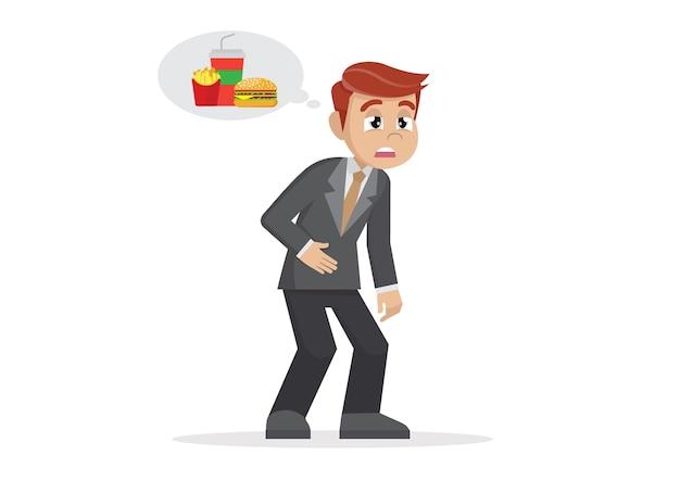 Geschäftsmann, der sich müde fühlt und an lebensmittel denkt