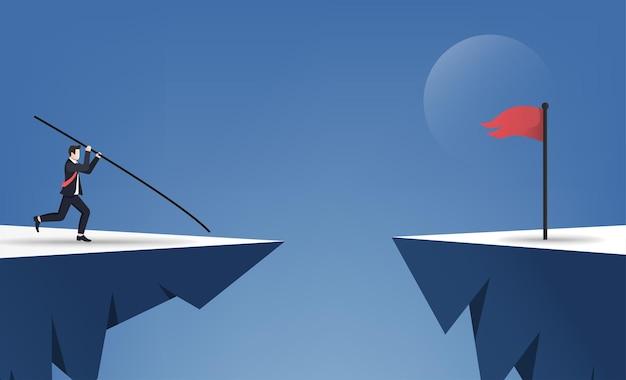 Geschäftsmann, der stabhochsprung tut, um über das konzept der roten fahne zu springen.