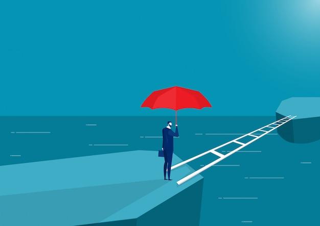 Geschäftsmann, der stehenden denkenden überfahrtbrücke des roten regenschirmes vorwärts zum neuland hält
