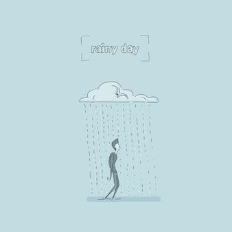 Geschäftsmann, der unter regen-wolken-regnerischem tagesproblem-konzept steht