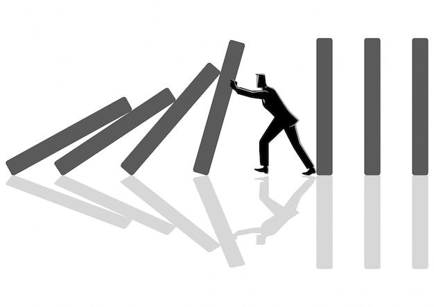 Geschäftsmann, der versucht, dominoeffekt zu stoppen