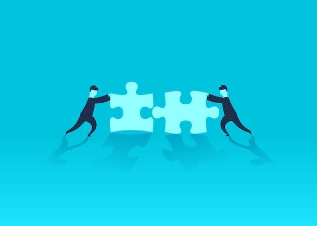 Geschäftsmann drängt puzzle, um es zu vervollständigen