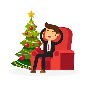 Geschäftsmann entspannen sich nahe weihnachtsbaum