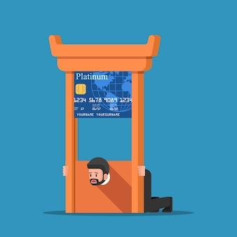 Geschäftsmann fest in kreditkarte guillotine.