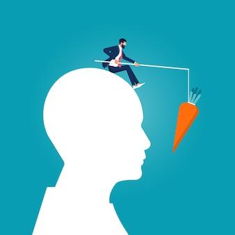 Geschäftsmann hält karotten auf einem stock anreiz- und personalmanagement-führung