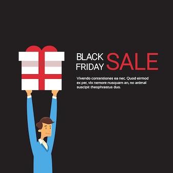 Geschäftsmann halten geschenk box holiday sale