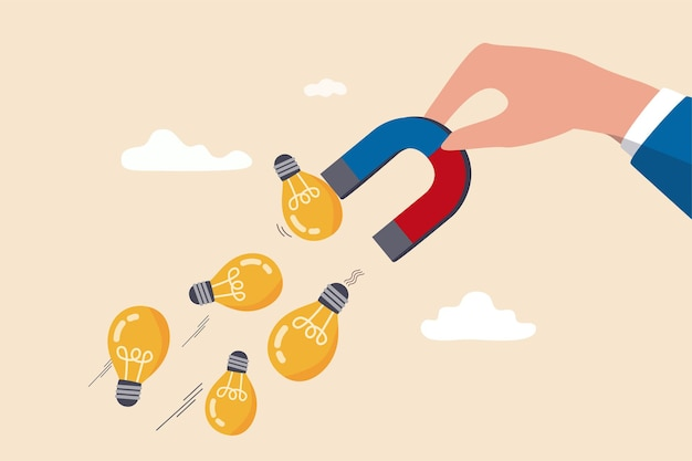 Geschäftsmann hand hält magnet, um glühbirnenlampe ideen zu magnetisieren oder zu zeichnen.