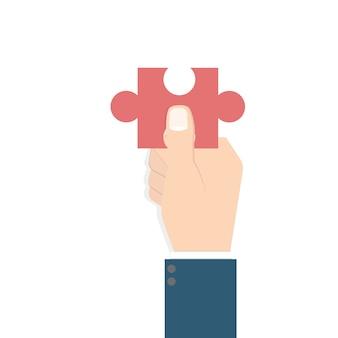 Geschäftsmann hand hält puzzle. problem- und lösungskonzept.
