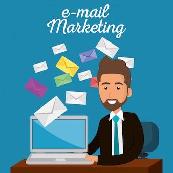 Geschäftsmann im büro mit e-mail-marketing-ikonen