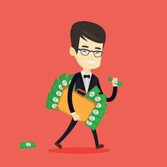 Geschäftsmann mit aktentasche voller geld.