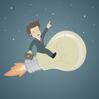 Geschäftsmann riding bulb am nachthimmel hintergrund.