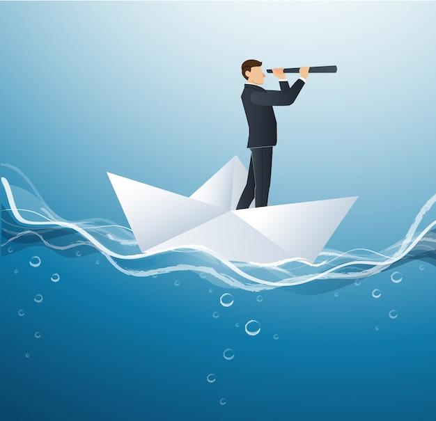 Geschäftsmann schaut durch teleskop auf papierboot