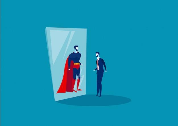 Geschäftsmann schaut in den spiegel und sieht einen superhelden.