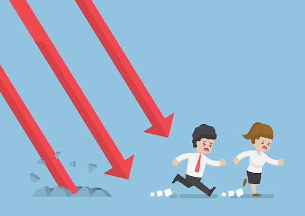 Geschäftsmann und geschäftsfrau laufen weg vom fallenden graphen