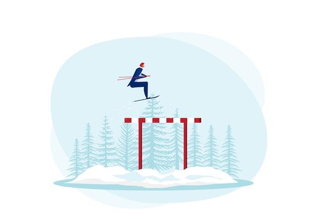 Geschäftsmann verwenden himmel, der über hürden oder hindernisse auf schneehintergrund springt.