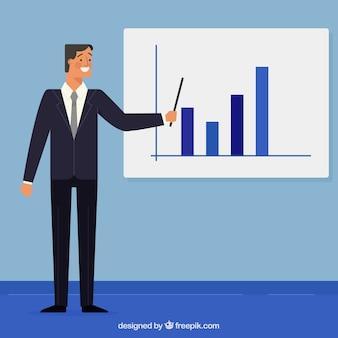 Geschäftsmann zeigt auf ein brett mit grafiken