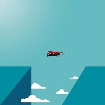 Geschäftsmannfliegen erreichen die andere seite der klippe