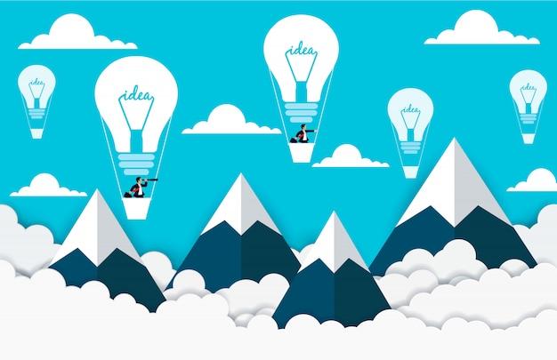 Geschäftsmannfliegen in den heißluftballonen auf dem himmel zwischen wolke und berg