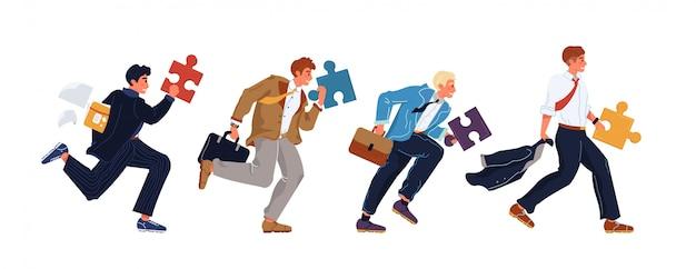 Geschäftsmanngruppe, die puzzleteil hält