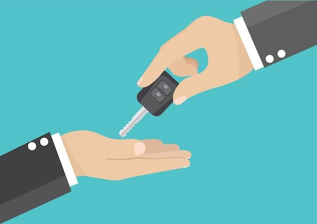 Geschäftsmannhand, die den autoschlüssel gibt