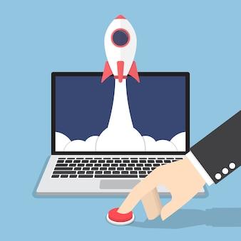 Geschäftsmannhand, die den knopf drückt, um rakete vom laptop-monitor zu starten