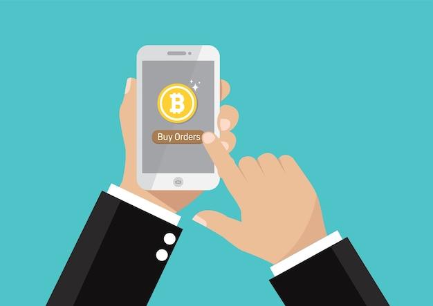 Geschäftsmannhand, die smartphone für kauf bitcoins hält.