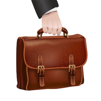 Geschäftsmannhand hält ledernen aktenkoffer
