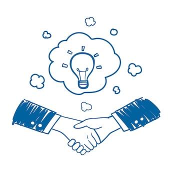 Geschäftsmannhanderschütterung mit gezeichneter art der idee in der hand