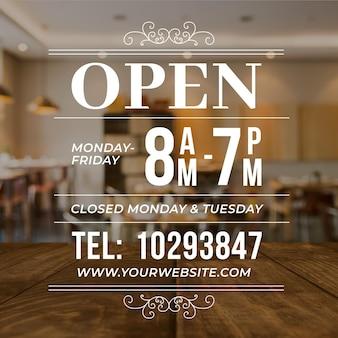 Geschäftsöffnungszeiten mit foto