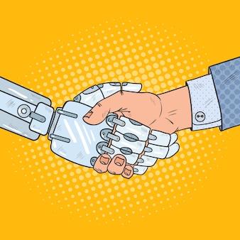 Geschäftsroboter und menschlicher handschlag