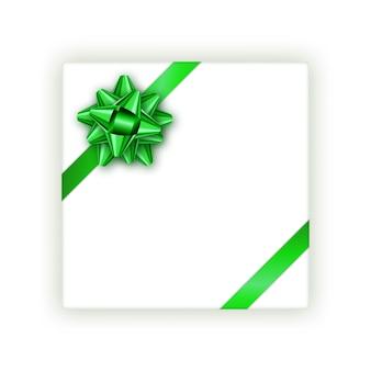 Geschenkbox mit einem grünen gebundenen bogen und einem realistischen schatten