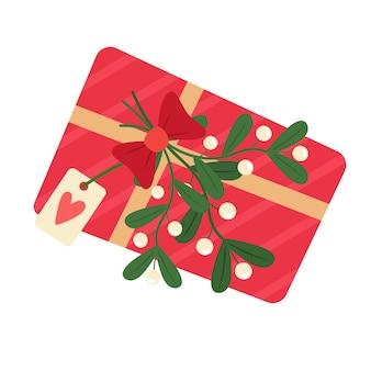 Geschenkbox mit mistelzweig und postkarte. im flachen cartoon-stil.