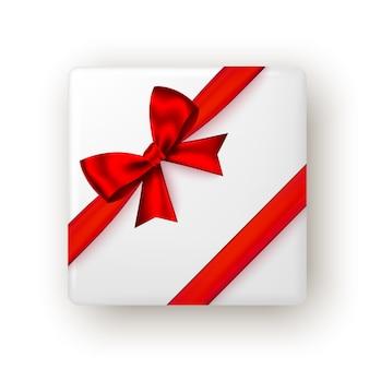 Geschenkbox mit rotem band und schleife