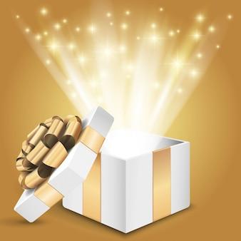 Geschenkbox mit strahlendem licht. illustration
