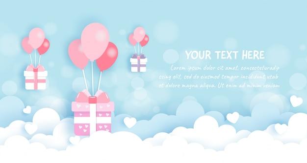 Geschenkboxen mit ballonen auf dem himmel im papierschnitt
