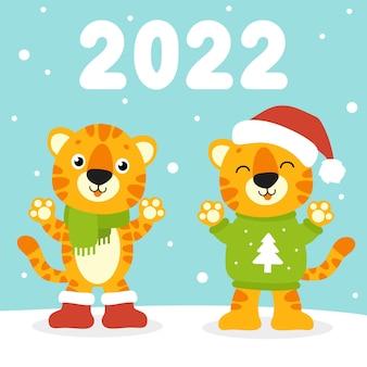 Geschenkfarbe grußkarte tiger in einer weihnachtsmütze neues jahr und frohe weihnachten