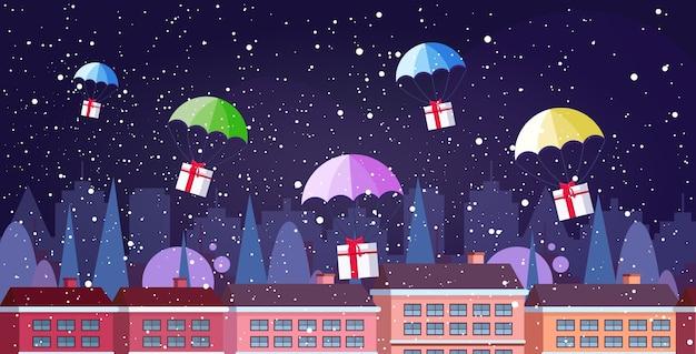 Geschenkgeschenkboxen, die mit fallschirmen herunterfallen frohe weihnachten frohes neues jahr luftpost expresszustellung