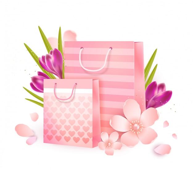 Geschenktüten umgeben von apfelblüten und krokussen.