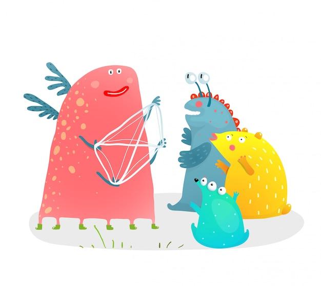 Geschichtenerzähler mit streichern und kindermonstern. lustige monsterfigur, die geschichte mit fäden in den händen für kinder erzählt.