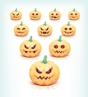 Geschnitzte halloween-kürbisse auf weiß gesetzt.
