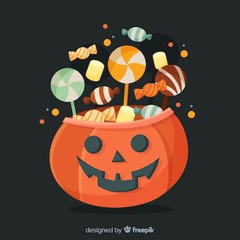 Geschnitzter kürbis mit süßigkeiten für halloween