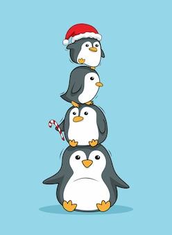 Gestapelte pinguine frohe weihnachten